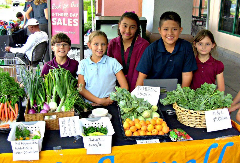 students at a farmer's market